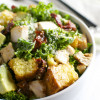 Kale Caesar Salad with Chicken, Sun Dried Tomatoes, Avocado, and Cornbread Croutons
