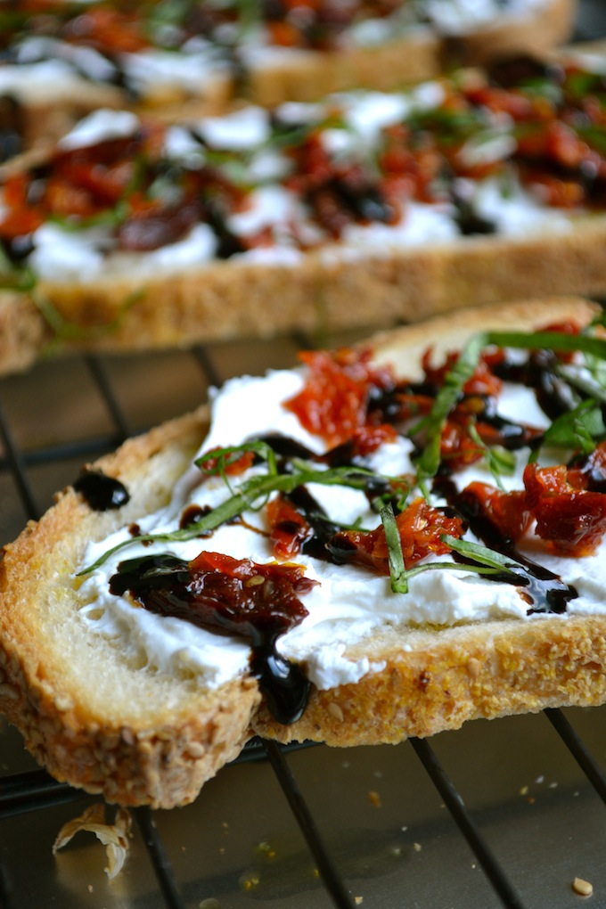 Goat Cheese and Sun Dried Tomato Crostini - Stuck On Sweet